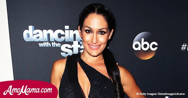 Nikki Bella shares a photo of her hubby, revealing his washboard abs and massive muscular arms