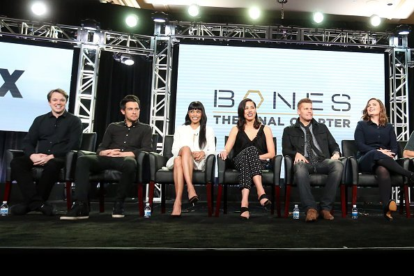 Eric Millegan, John Boyd, Tamara Taylor, Michaela Conlin, David Boreanaz, and Emily Deschanel of the television show 'Bones' speak onstage during the FOX portion of the 2017 Winter Television Critics Association Press Tour at Langham Hotel on January 11, 2017, in Pasadena, California. | Source: Getty Images.