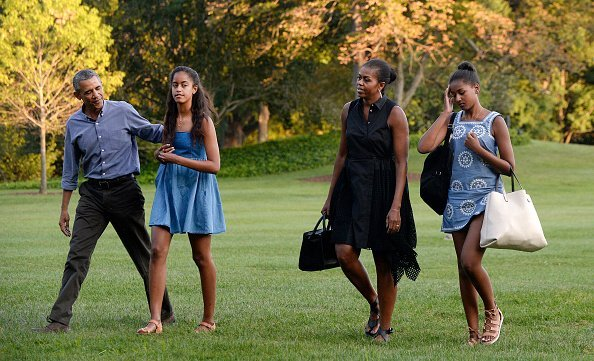 The Obamas arrive at the White House in Washington, D.C on August 23, 2015 upon their return from vacationing at Martha's Vineyard | Photo: Getty Images