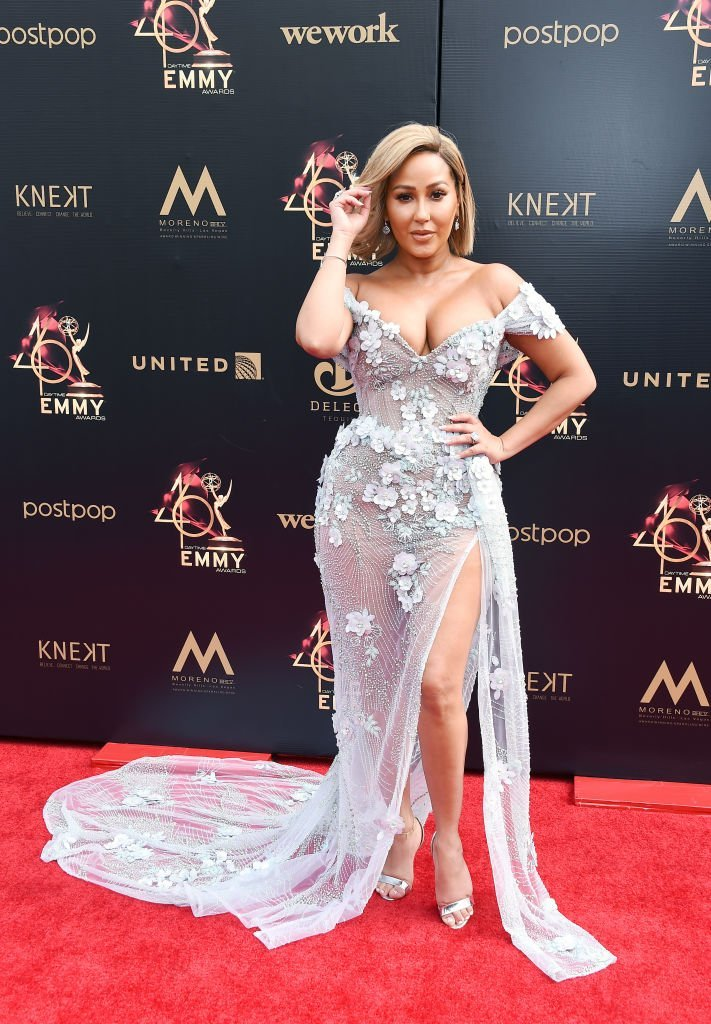 """The Real"" host Adrienne Bailon on the red carpet at the Daytime Emmy Awards on May 5, 2019. 