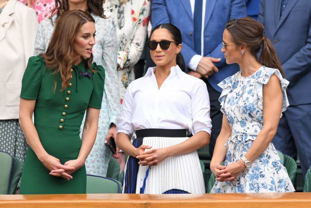 Kate Middleton, Meghan Markle, and Pippa Middleton in the Royal Box on Centre Court during day twelve of the Wimbledon Tennis Championships at All England Lawn Tennis and Croquet Club | Photo: Getty Images