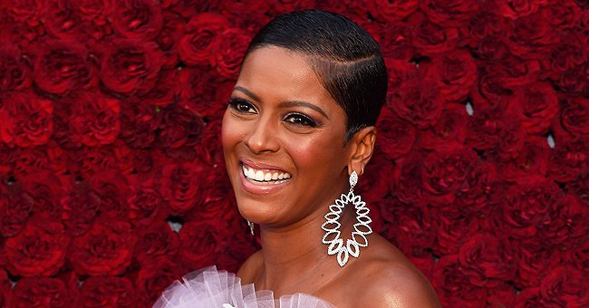 Tamron Hall Smiles with Her Son Who Wore a Helmet While Riding on the Back Seat of Her Bicycle