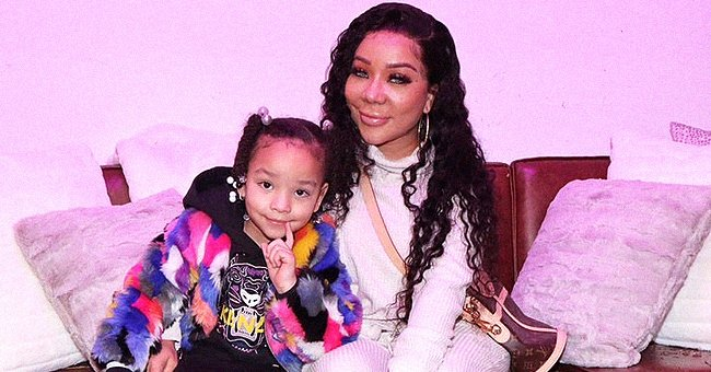 Tiny Harris' Daughter Heiress Melts Hearts Posing with Her Mom in a Black Dress & Colorful Coat