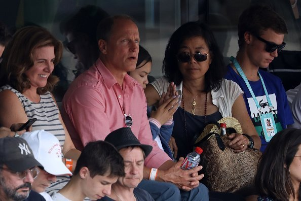Actor Woody Harrelson and his wife Laura Louie at the 2018 French Open - Day Thirteen on June 8, 2018 | Photo: Getty Images