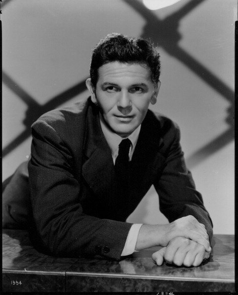 Portrait of actor John Garfield wearing a black suit and tie, circa 1945 | Photo: Getty Images