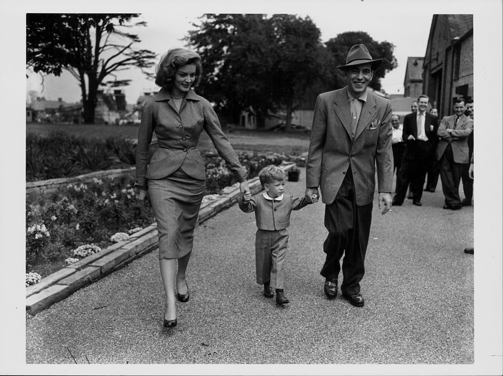 Lauren Bacall, Humphrey Bogart and their son Stevie pictured leaving studios at Isleworth, 1951. | Photo: Getty Images