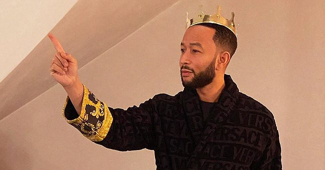 John Legend Looks like a King Posing in a Versace Bathrobe with a Crown on His Head (Photo)
