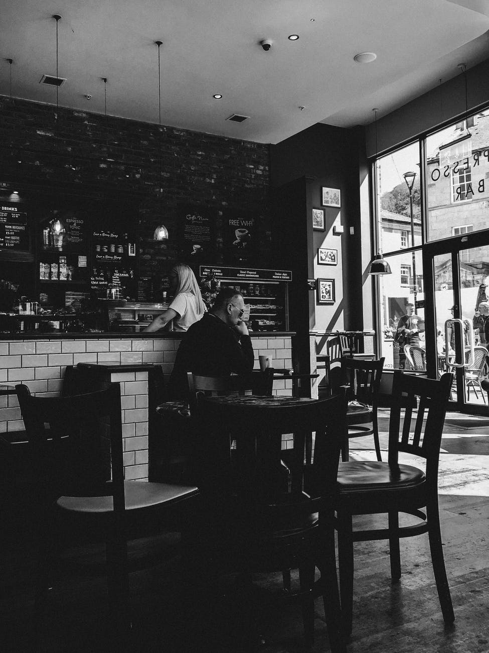 A man seating alone in a bar | Photo: Pexel