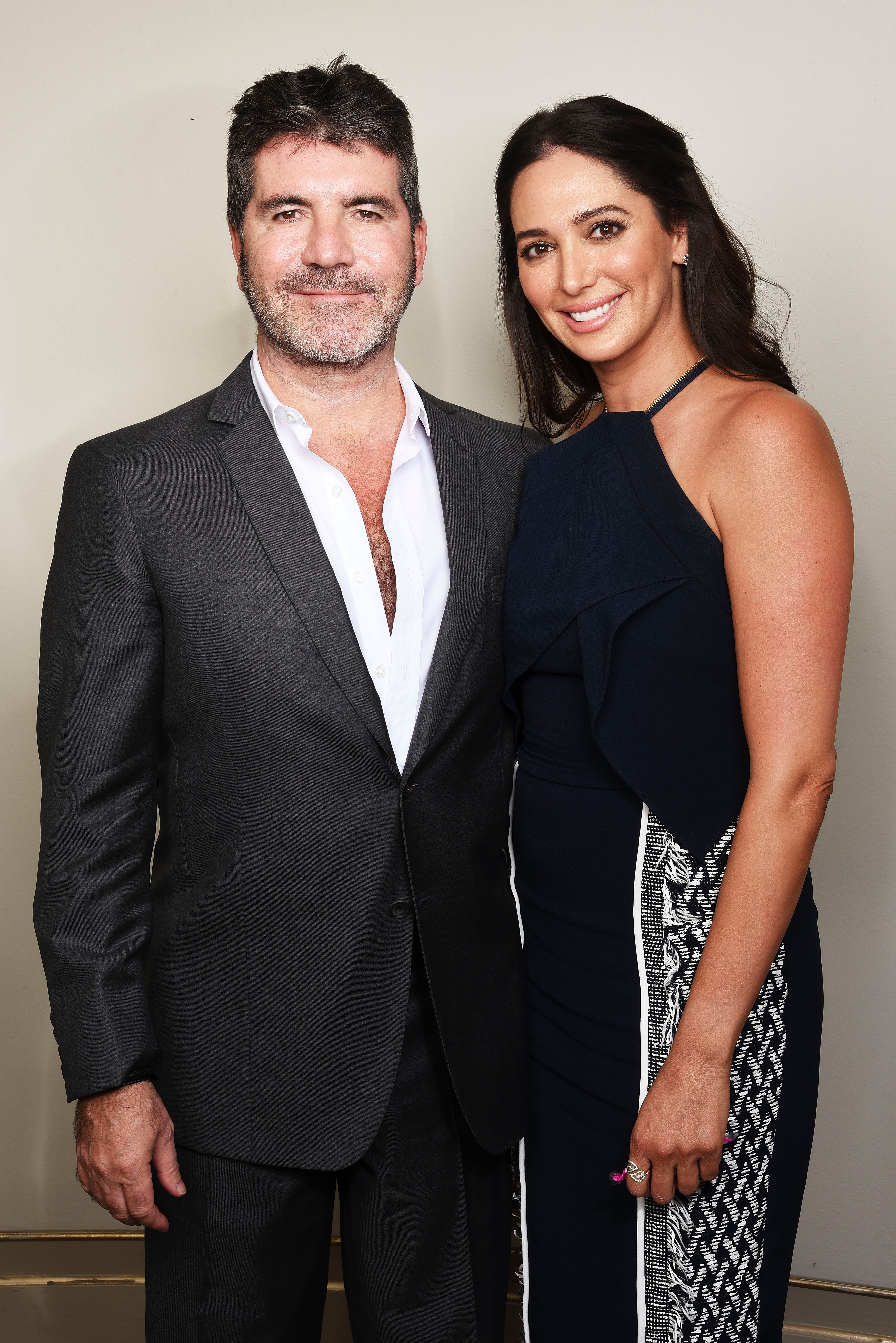 Simon Cowell and Lauren Silverman at a Shooting Star Chase Children's Hospice event on May 27, 2016, in London, England | Photo: Getty Images