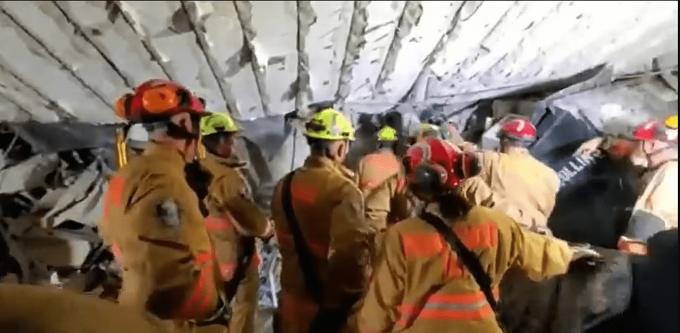 Recue workers are attempting to access parts of the rubble through the building's basement. | Photo: DailyMail