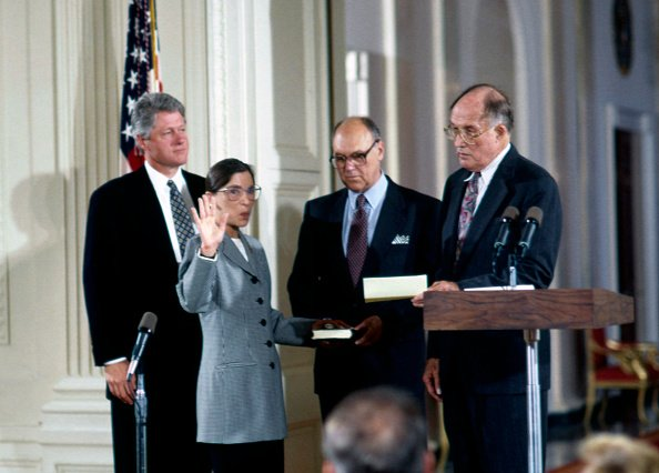 Marty holds the bible as Ruth is sworn in as a Supreme Court justice of the United States, Washington, DC, on August 10, 1993. | Photo: Getty Images