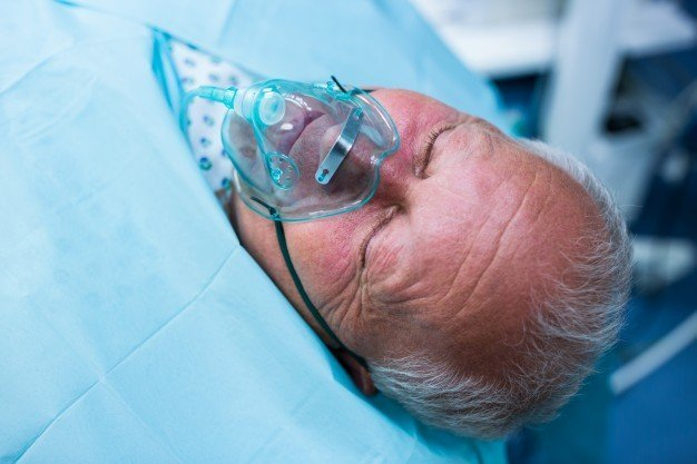 Patient laying on hospital bed | Shutterstock
