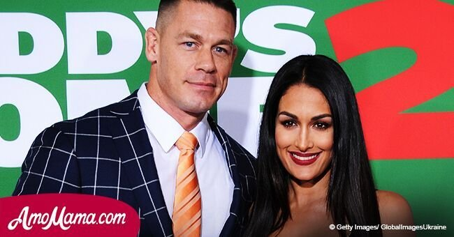 John Cena and Nikki Bella share a very passionate kiss in public. The couple look so in love