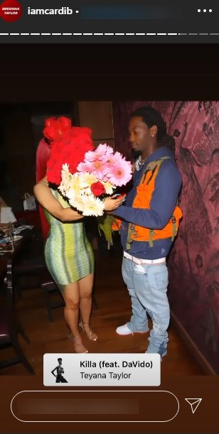 A picture of Offset handing over a bouquet to his boo, Cardi B. | Photo: Instagram/Iamcardib