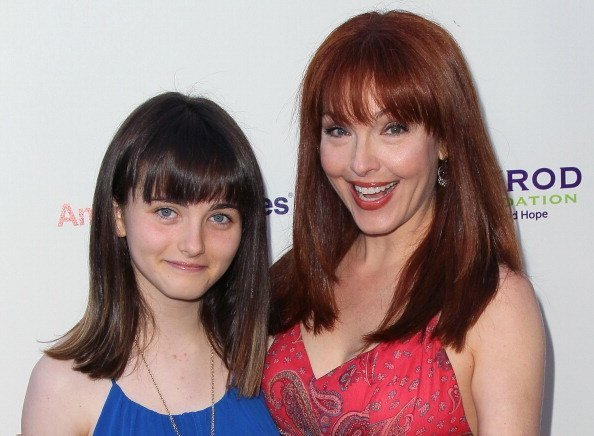 Amy Yasbeck and Stella Ritter (Noah Lee) on July 21, 2012 in Malibu, California | Photo: Getty Images
