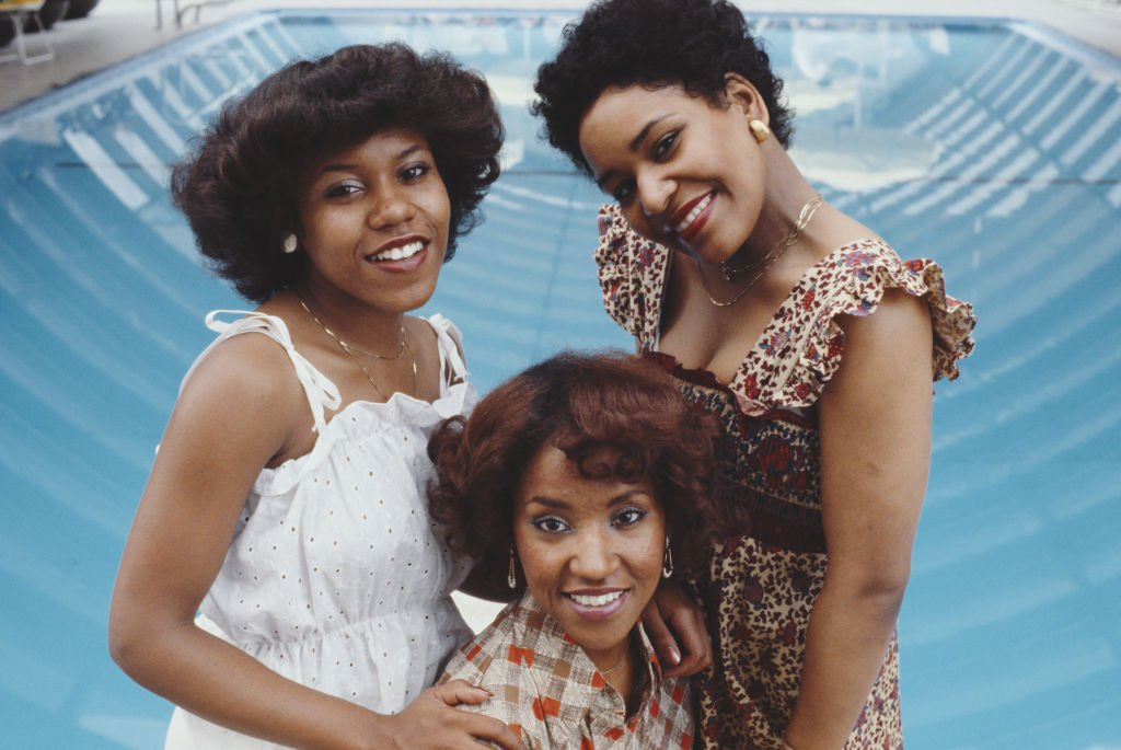 A 1977 photo of The Emotions band singers Pamela Hutchinson, Wanda Hutchinson, and Sheila Hutchinson. | Getty Images