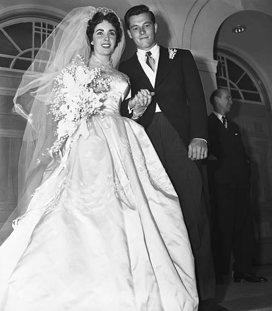 Mr. and Mrs. Conrad Hilton Jr. on the steps of the Church of the Good Shepherd after their wedding.  |  Photo: Getty Images