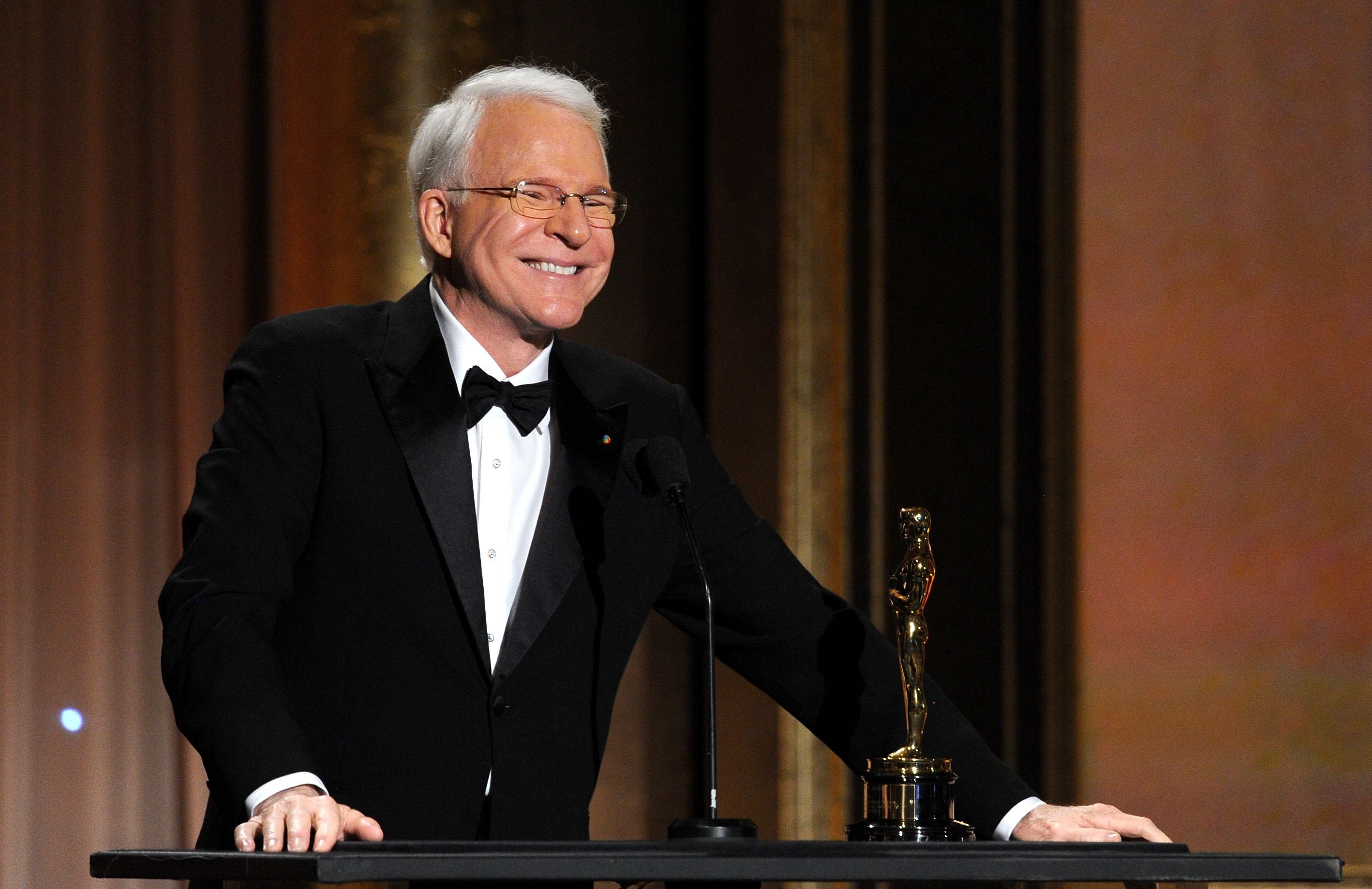 Steve Martin accepts honorary award onstage during the Academy of Motion Picture Arts and Sciences' Governors Awards. | Source: Getty Images