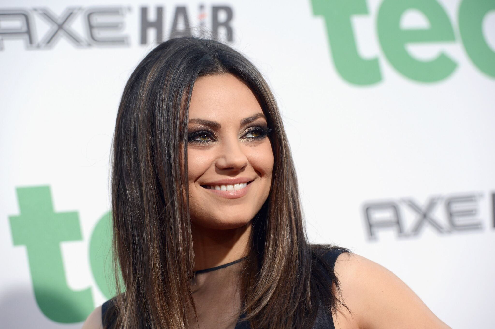 "Mila Kunis arrives at the Premiere of Universal Pictures' ""Ted"" sponsored in part by AXE Hair 