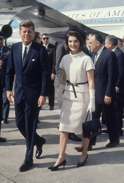 President and Mrs. John F. Kennedy arriving Texas airport on November 21, 1963   Source: Getty images
