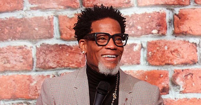 D L Hughley Is All Smiles in a Sweet Photo with His Only Granddaughter Nola Relaxing on His Lap