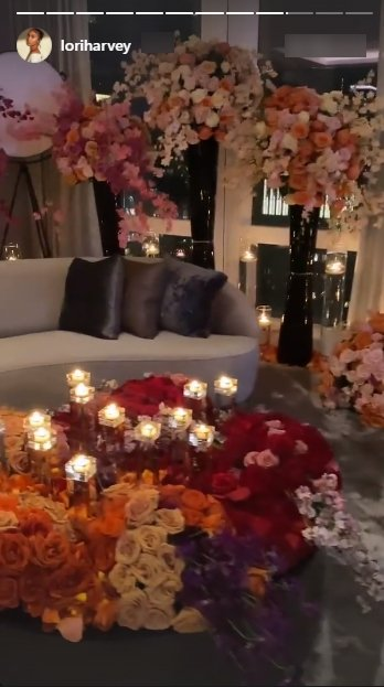Lori Harvey shares a picture of her hotel room filled with candles and flowers on Valentine's day. | Photo: Instagram/Loriharvey