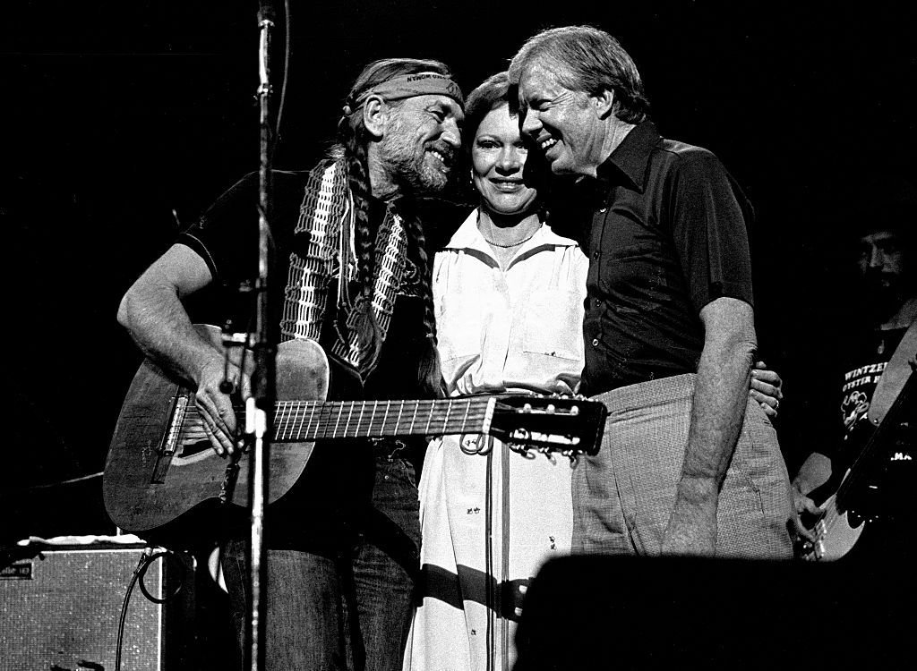 Former President Jimmy Carter with Former First Lady Rosalynn join Willie Nelson and perform at The Omni Coliseum in Atlanta Georgia. December 12, 1982. | Source: Getty Images