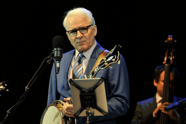 Steve Martin performs with the Steep Canyon Band at Hammersmith Apollo. | Source: Getty Images