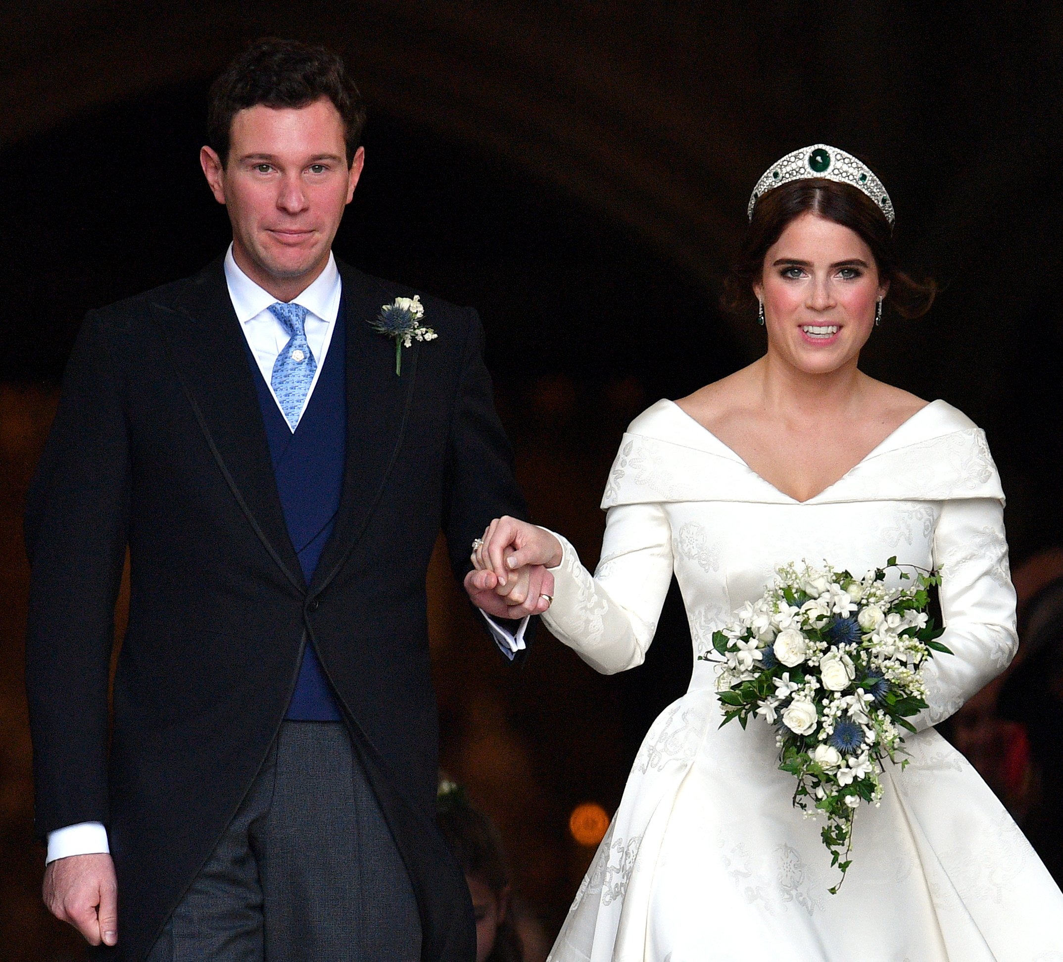 Jack Brooksbank and Princess Eugenie leave St George's Chapel after their wedding ceremony on October 12, 2018, in Windsor, England. | Source: Getty Images.