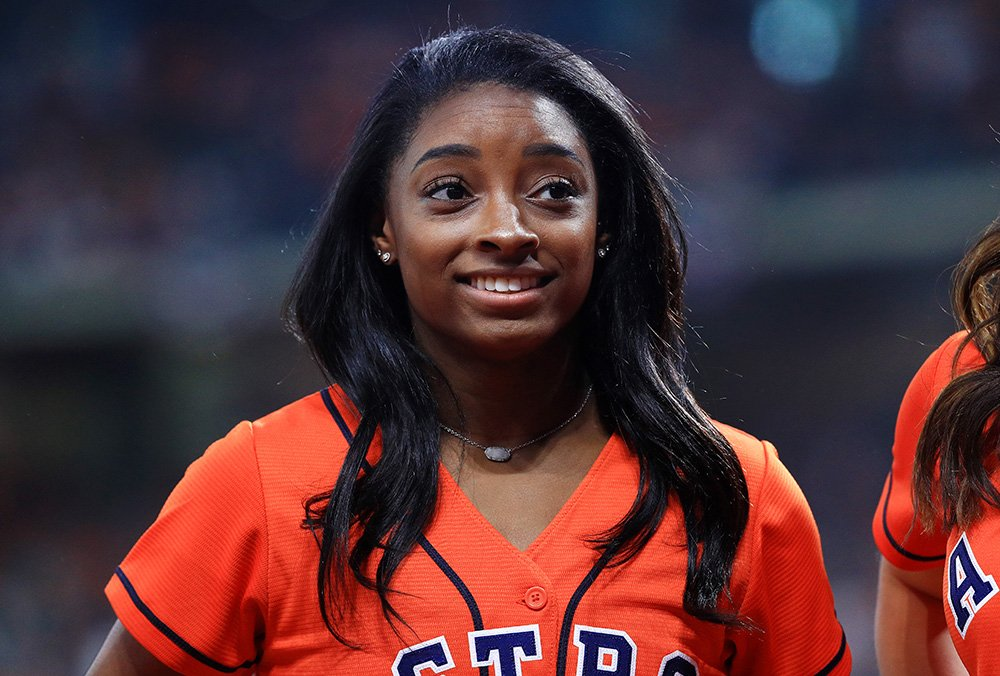 Gymnast Simone Biles looks on prior to Game Two of the 2019 World Series between the Houston Astros and the Washington Nationals at Minute Maid Park on October 23, 2019 in Houston, Texas. I Image: Getty Images.