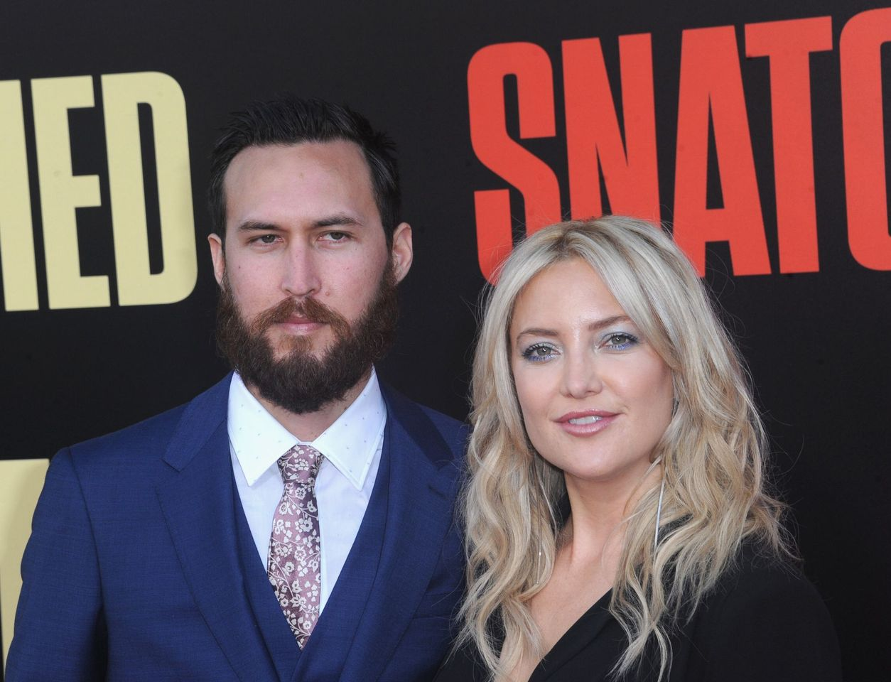 "Danny Fujikawa and Kate Hudson during the premiere of ""Snatched"" on May 10, 2017, in Westwood, California. 