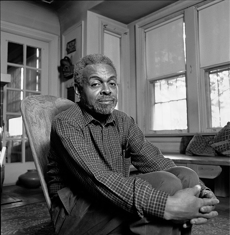 Portrait of American poet and playwright Amiri Baraka (born as LeRoi Jones) in his home in Newark, New Jersey in 1991. I Image: Getty Images.