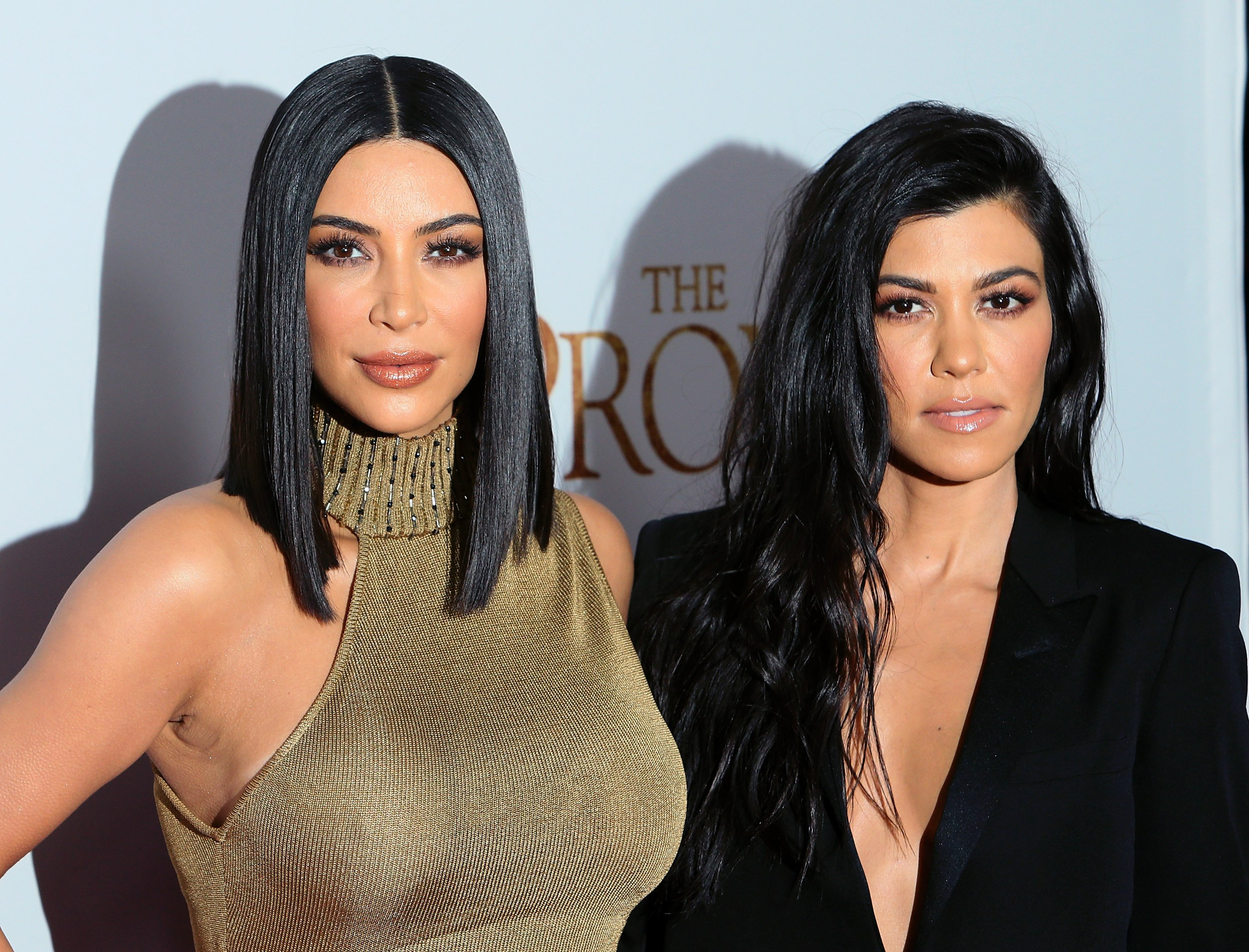 """Kim Kardashian West and Kourtney Kardashian at the premiere of """"The Promise"""" at TCL Chinese Theatre on April 12, 2017 in Hollywood, California. 