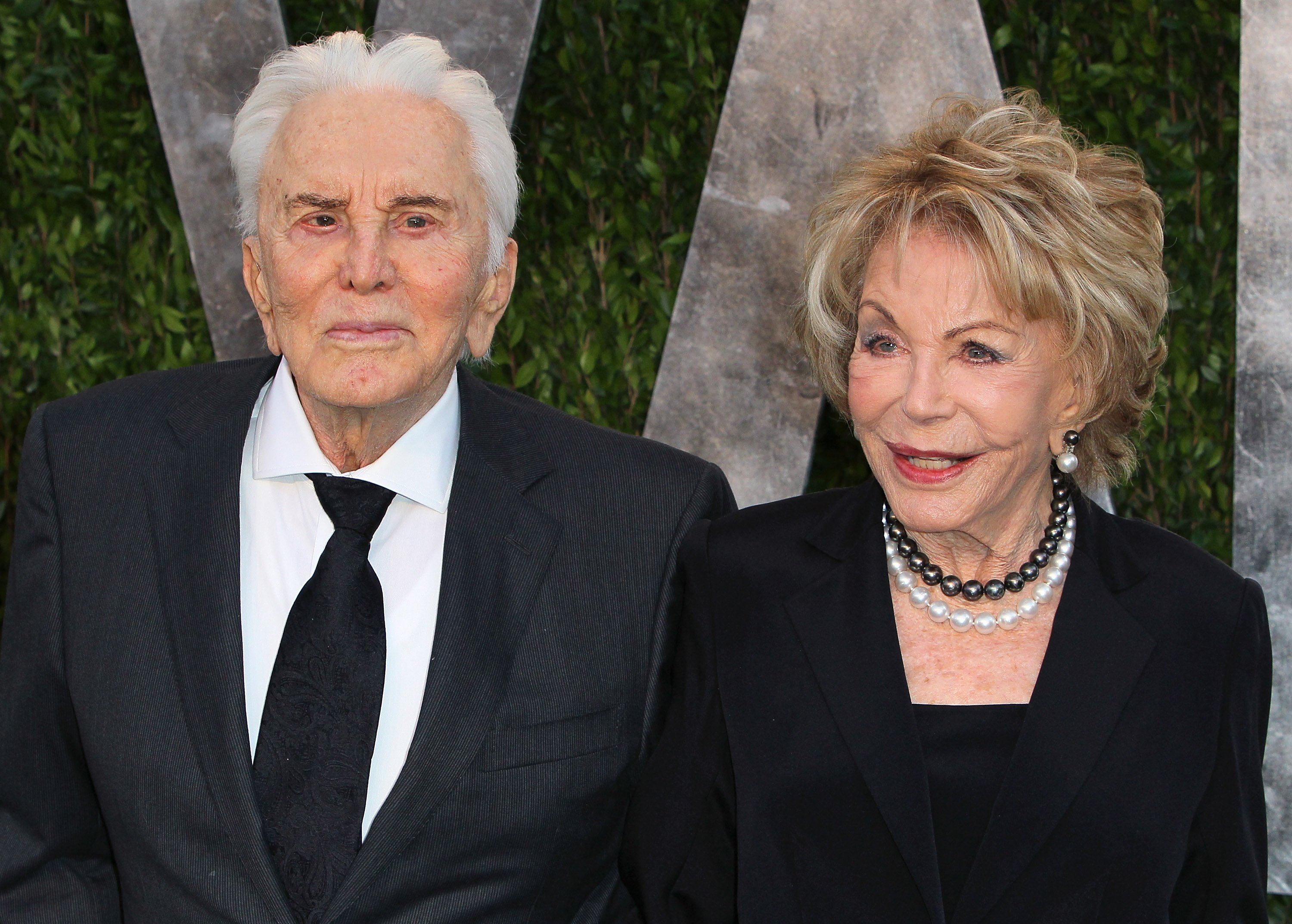 Kirk Douglas and wife Anne Douglas attend the 2013 Vanity Fair Oscar Party at the Sunset Tower Hotel on February 24, 2013, in West Hollywood, California. | Source: Getty Images.