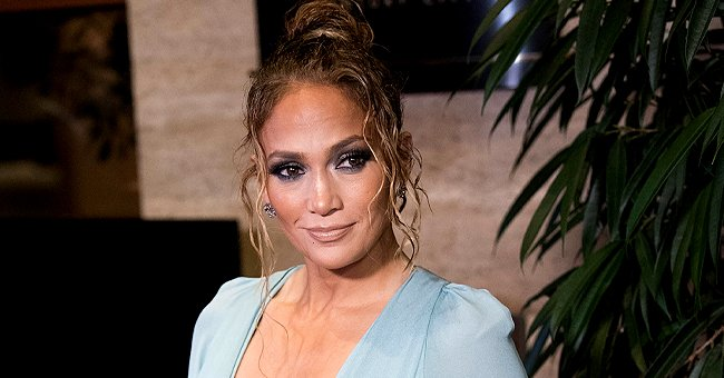 See J Lo, 51, Flaunt Her Incredible Age-Defying Body in a White Knitted Top & Blue Ripped Jeans
