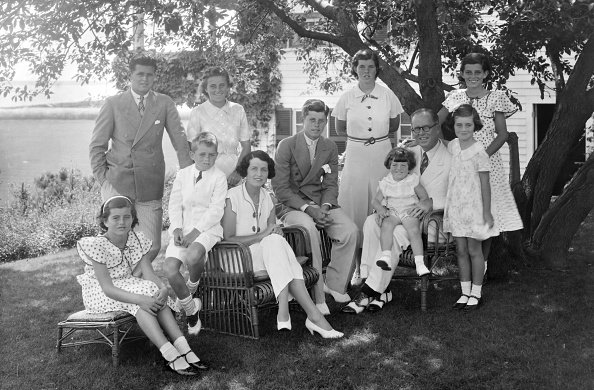 A portrait of the Kennedy family as they sit in the shade of some trees in Hyannis, Massachussetts, circa 1930.   Photo: Getty Images