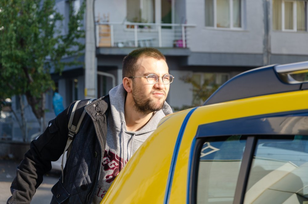 Irritated man getting into a cab. | Image: Shutterstock