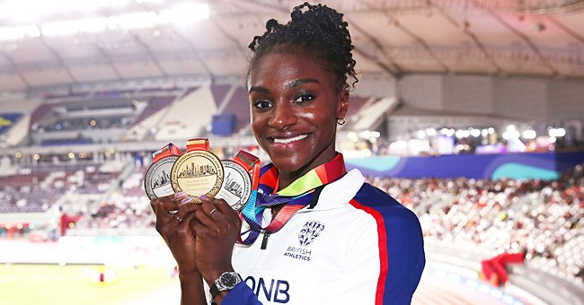 Dina Asher-Smith of Great Britain poses with her three championship medals during day ten of the 17th IAAF World Athletics Championships at Khalifa International Stadium on October 06, 2019 | Photo: Getty Images