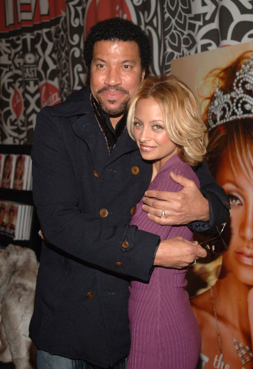 "Lionel Richie and Nicole Richie share a moment at the ""The Truth About Diamonds"" book signing. 