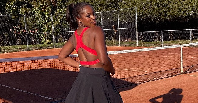 Sloane Stephens Shows off Her Toned Back Sporting a Red Top & Black Pleated Skirt in New Photos