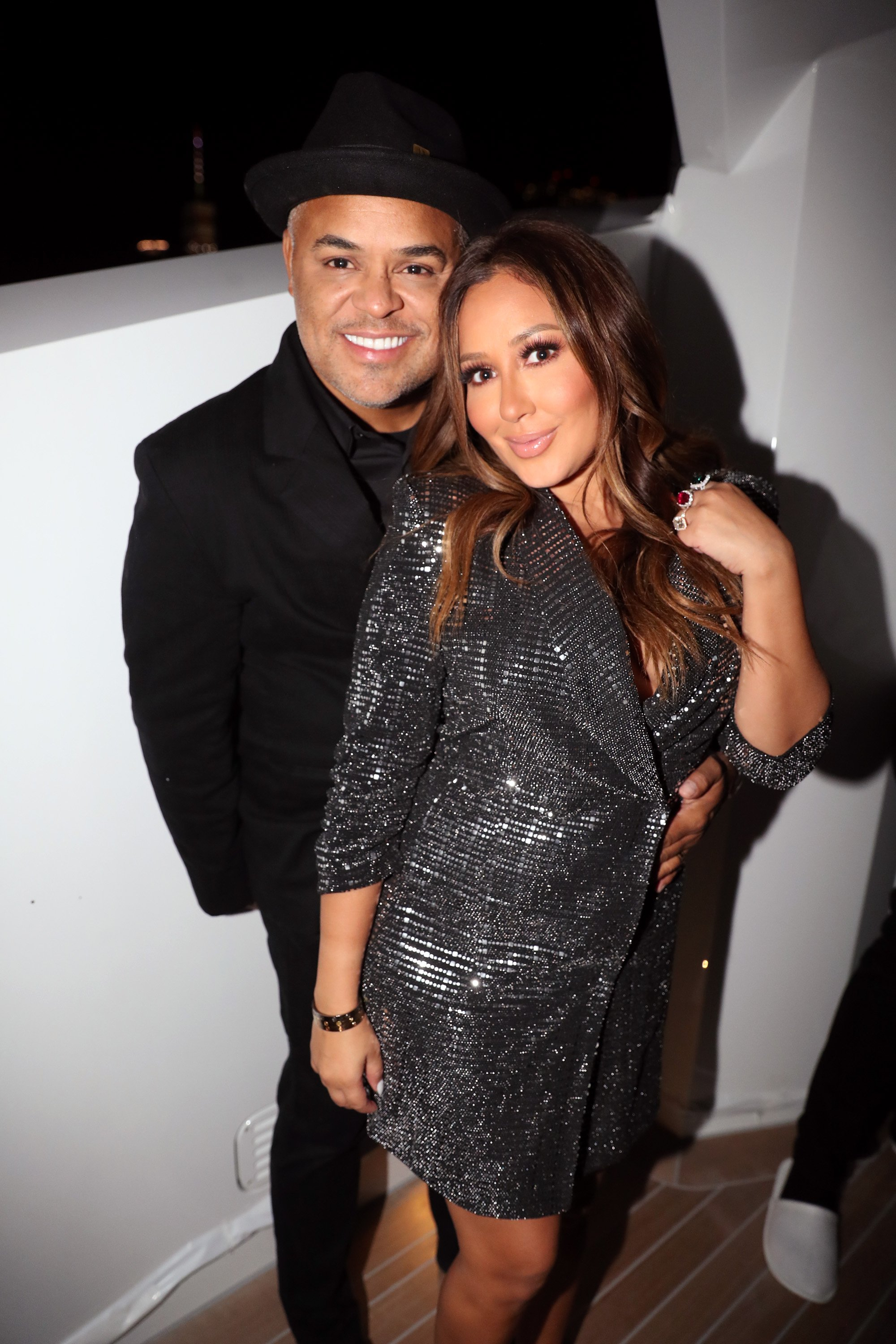 Israel Houghton and Adrienne Bailon at the Lumiere De Vie Hommes Launch Event Aboard Superyacht Utopia IV on October 13, 2018 | Photo: GettyImages