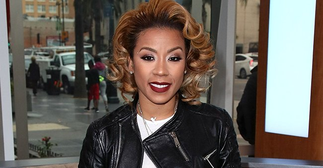 Check Out Keyshia Cole as She Exudes Glamour in a Plunging Pink Dress with High Slit