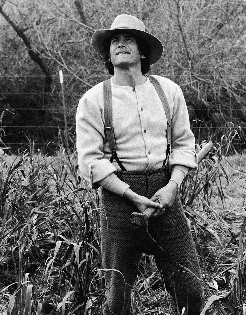 "Michael Landon stands in a field in a still from the television series, ""The Little House On The Prairie."" 