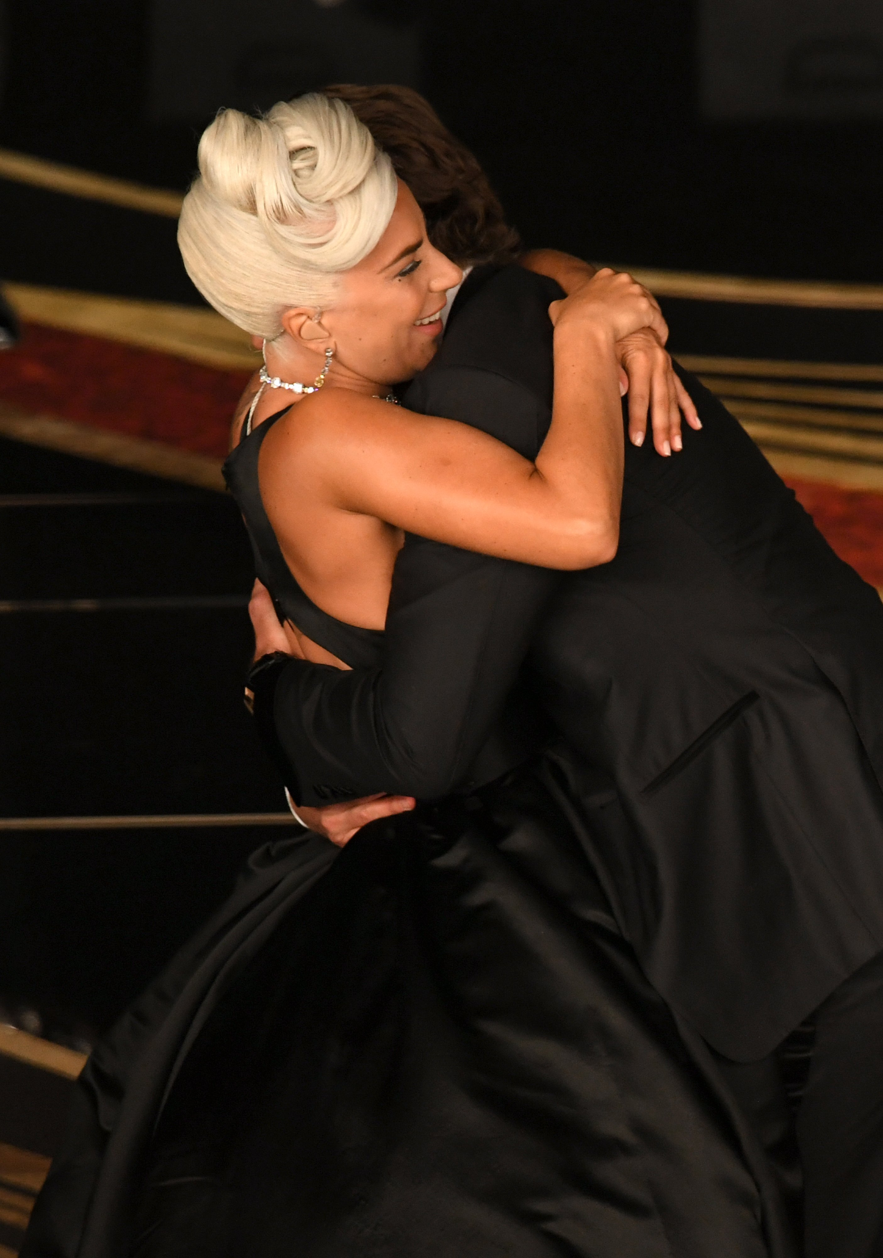 Lady Gaga and Bradley Cooper hugging on stage at the 91st Annual Academy Awards | Photo: Getty Images