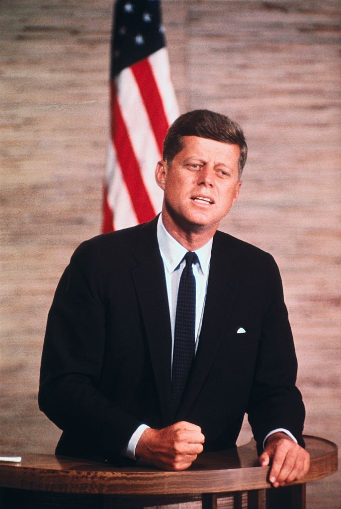 A portrait of Late John F. Kennedy Speaking on a Podium on October 01, 1960 | Photo: Getty Images