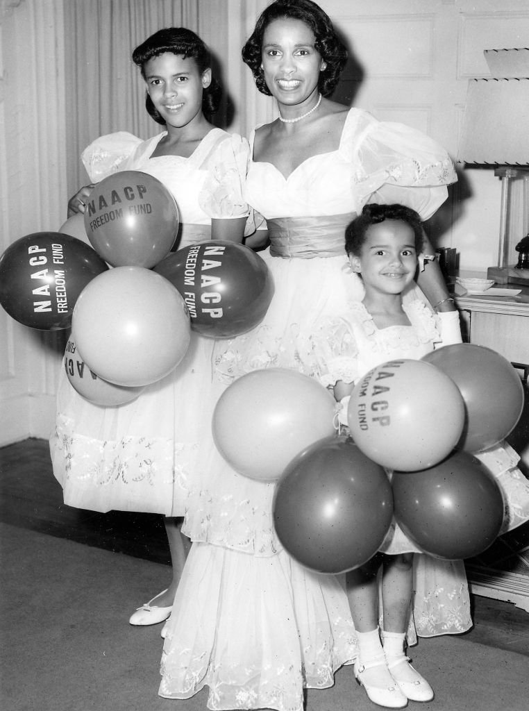 Jazz musician Harry Belafontes wife Marguerite Belafonte and daughters carrying a large number of balloons during an NAACP Freedom Drive, 1958.   Photo: Getty Images