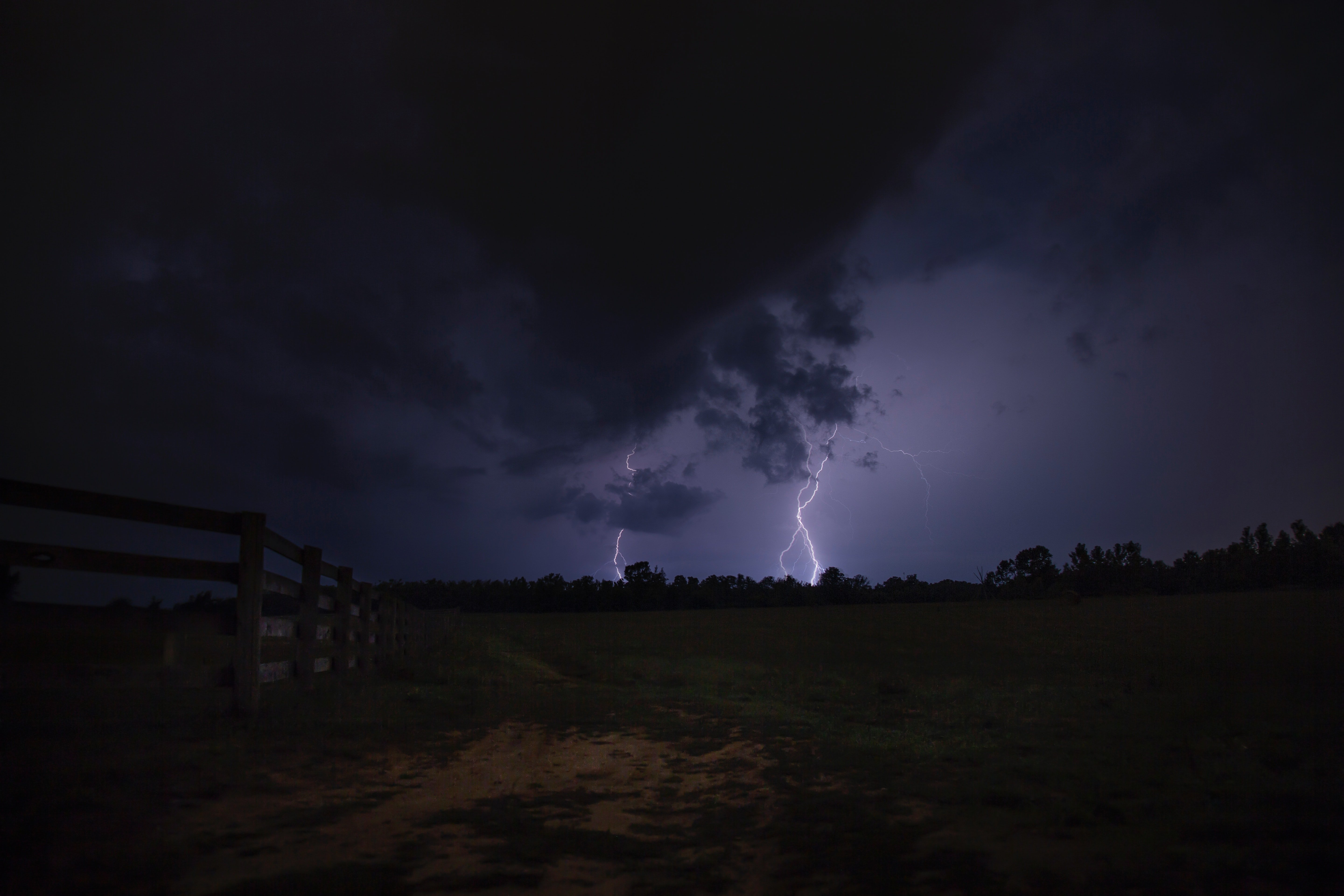 Photo - A photo of lightning strikes the ground during the night |  Source: Pexels