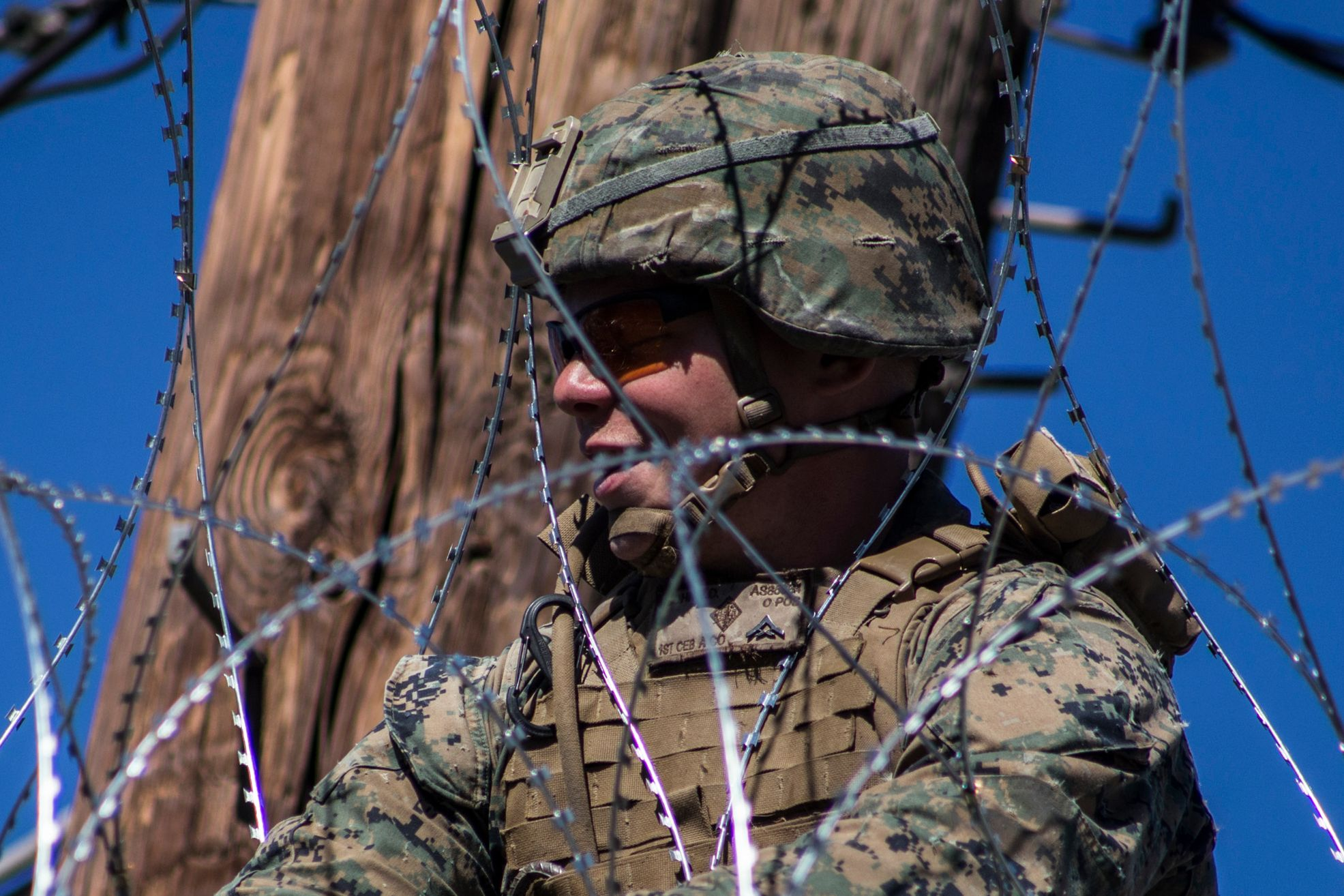 U.S. Army soldiers are seen from the US-Mexico border wall with barbed wire on November 26, 2018 in Mexicali, Mexico. | Source: Getty Images