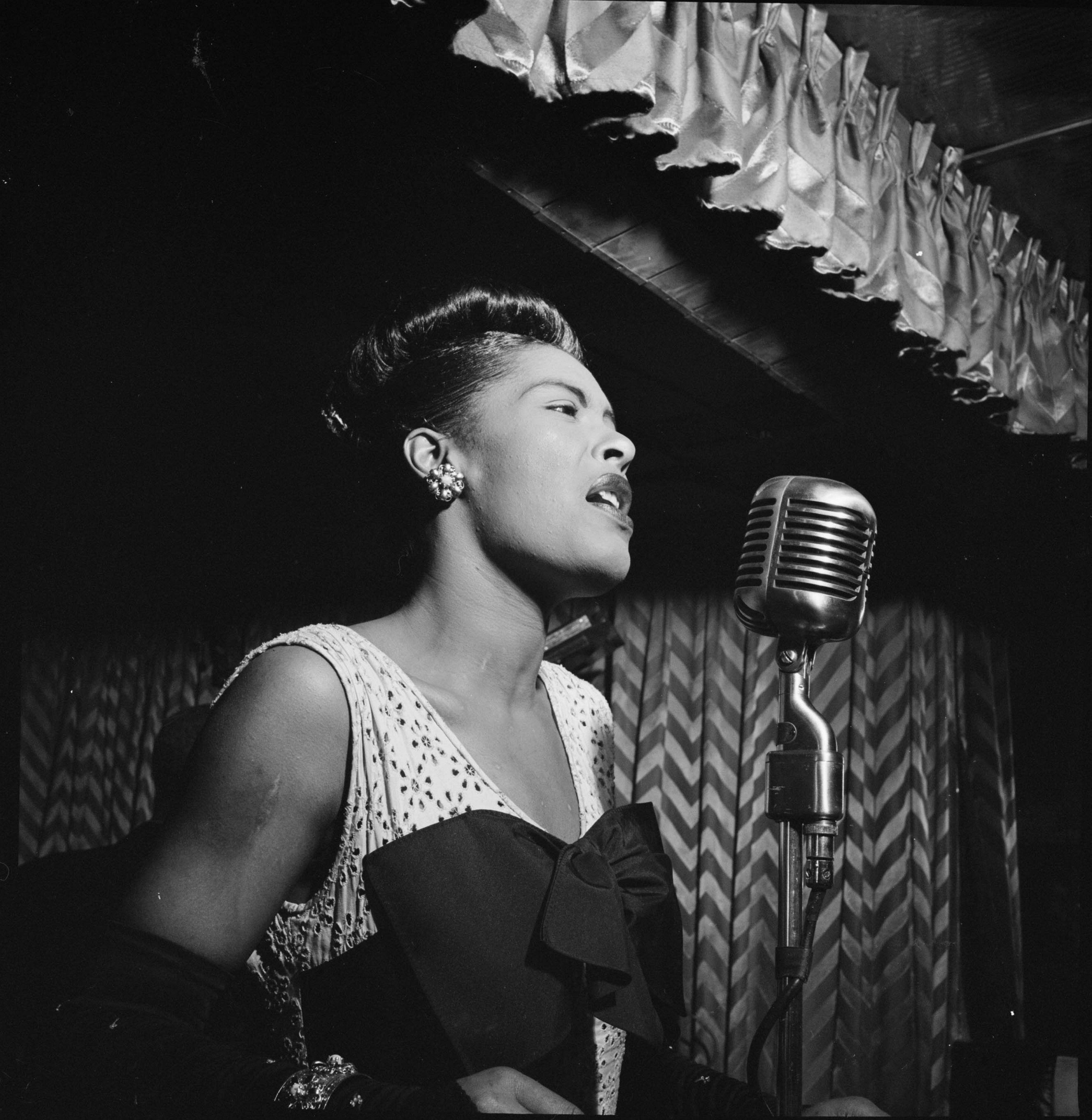 Billie Holiday (1915 - 1959) performing at the Club Downbeat in Manhattan.   Photo: Getty Images