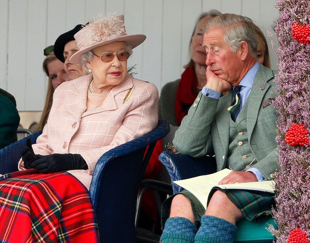 Queen Elizabeth II and Prince Charles, Prince of Wales attend the annual Braemar Highland Games at The Princess Royal and Duke of Fife Memorial Park. | Source: Getty Images